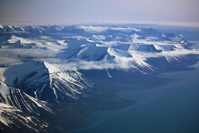 Svalbard mountain tops in the clouds seen from the sky