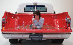 1968 GMC Photo Shoot Looking at the back of the truck the tailgate is down there is a girl in the back of the truck
