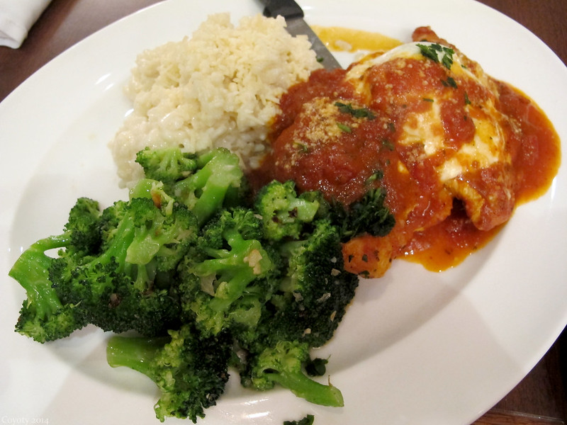 Chicken parmesan with garlic broccoli and risotto