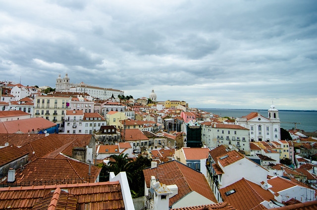 The red roofs of Lisbon and the River Tagus viewed from one of Lisbon's miradors.