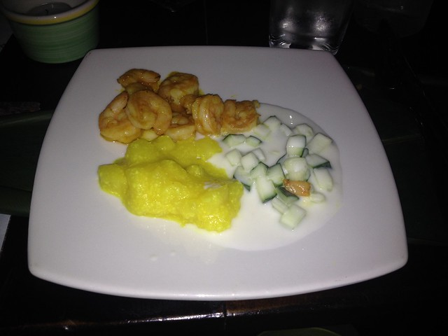 Shrimp in mildly spicy red sauce, cucumbers in yogurt, and mango