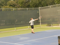luxury vehicle(0.0), tournament(0.0), sport venue(1.0), soft tennis(1.0), tennis court(1.0), tennis(1.0), sports(1.0), tennis player(1.0), net(1.0), ball game(1.0), racquet sport(1.0),