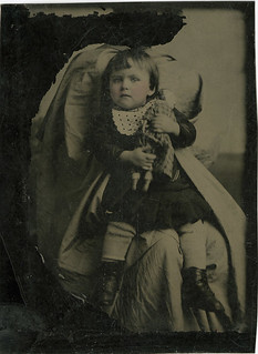 Scratched Out Hidden Mother Holding a Child with a Doll - Tintype
