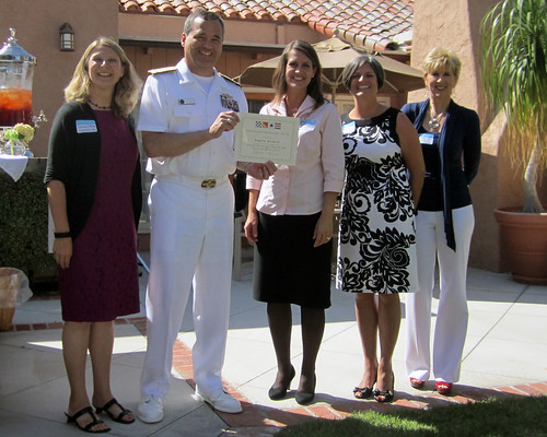 Vice Adm. Tom Copeman, and Naval Officers' Spouses' Club present Angela Nickerl the NOSC Spouse Scholarship