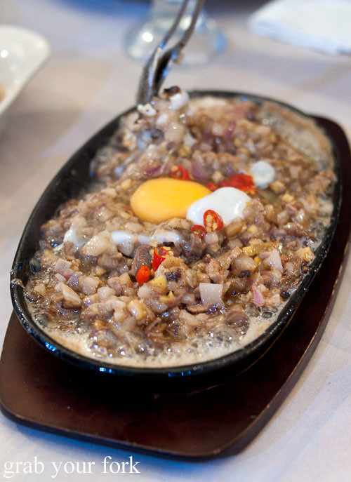 sizzling sisig pork head at lamesa phillipine cuisine haymarket chinatown
