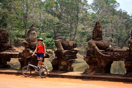 Lina hanging outside of Angkor Thom… Funny faced statue there