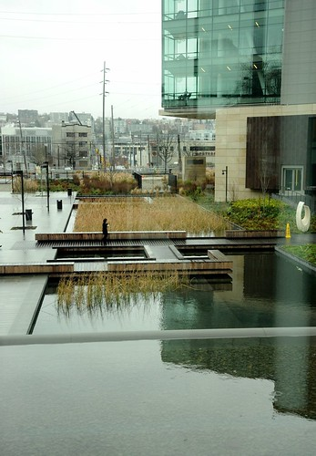Ponds and fountains, grasses, waterscaping, contemporary glass building, cloudy day, usual weather, Bill & Melinda Gates Foundation, Seattle, Washington, USA by Wonderlane