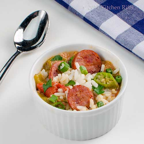 Chicken and Andouille Sausage Gumbo in ramekin, with spoon and napkin in background