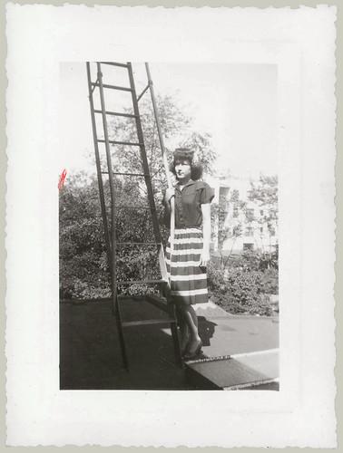 Girl by ladder