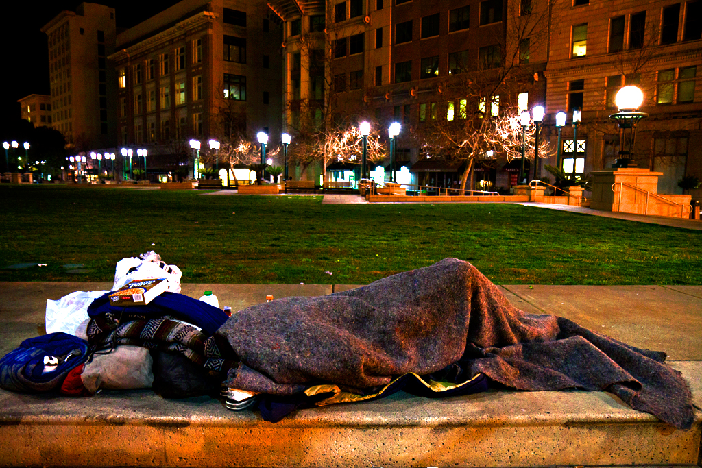 Sleeping-person-at-Ogawa-Plaza-on-3-10-13--Oakland