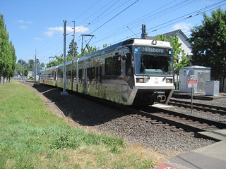 A Hillsboro-bound interurban approaches from the east