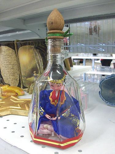 Tiny bottled woman