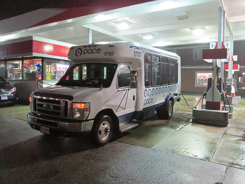 First Transit small Ford paratransit mini bus # 5707 being fueled up at the end of the shift.  Glenview Illinois.  Early December 2013. by Eddie from Chicago