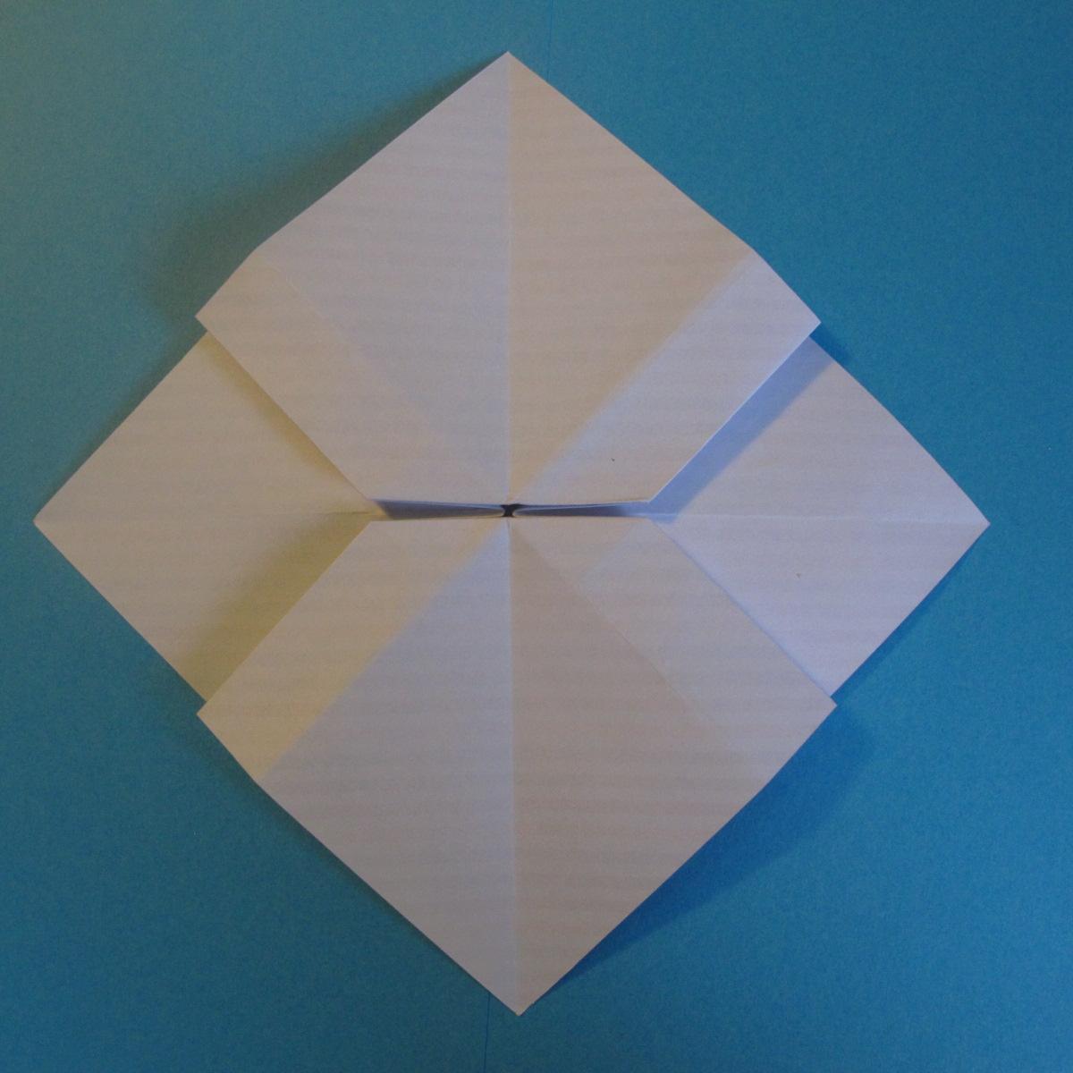 วิธีการพับกระดาษเป็นโบว์หูกระต่าย 016