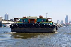 Heavy traffic on the Chao Phraya river, Bangkok, Thailand