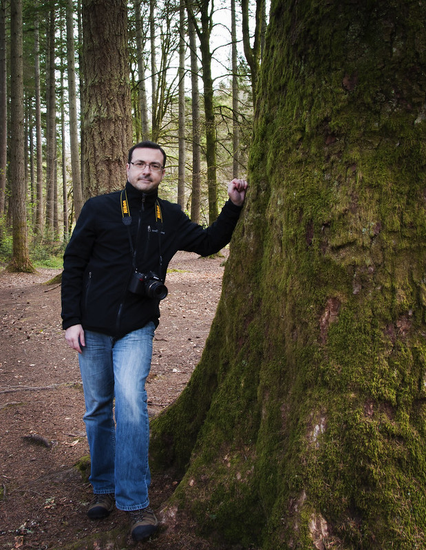 Frank standing against one of the huge Douglas fir trees at The Hermitage