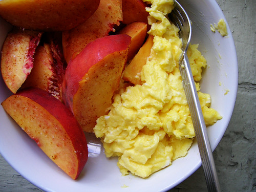 scrambled eggs and peaches with salt and cayenne