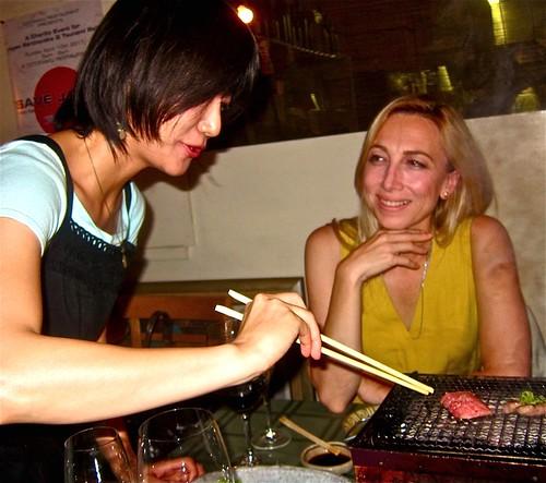 waitress wields chopsticks