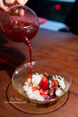 Course 15 - (Dessert) Pouring strawberry sauce on top of the lychee ice, strawberries, black garlic, shiso