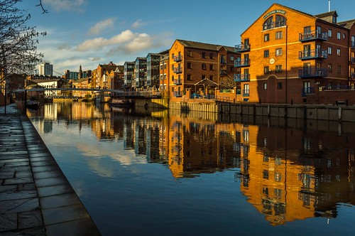 city bridge reflection building tree church window water clouds river centennial day balcony centre leeds trinity wharf aire barge towpath calls the langtons pwpartlycloudy