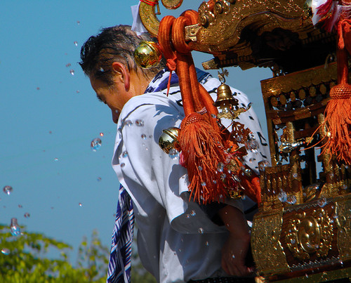 Throwing water on the omikoshi (Japanese shrine) during the Powell St. Festival in Vancouver