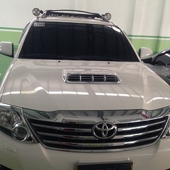 toyota camry(0.0), vehicle registration plate(0.0), automobile(1.0), automotive exterior(1.0), toyota(1.0), sport utility vehicle(1.0), toyota fortuner(1.0), vehicle(1.0), grille(1.0), bumper(1.0), land vehicle(1.0),
