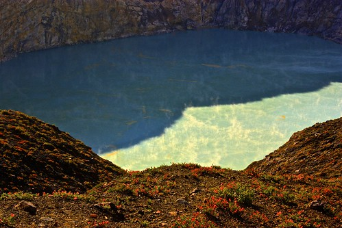 notice the orange swirls? That's minerals coming up to the top of the volcanic lake