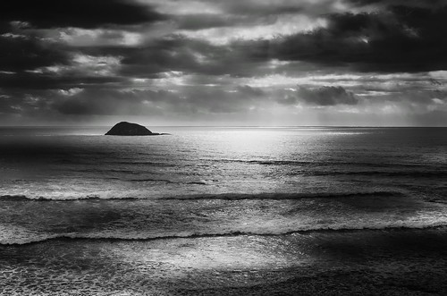 ocean light sea newzealand sky bw sunlight storm monochrome reflections dark landscape island one solitude alone darkness single lone muriwai