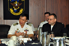 Capt. Giovanni Bacordo, general staff course officer for the Philippine Navy, left, speaks alongside U.S. Navy Capt. Tony Cowden, 7th Fleet's theater security cooperation officer, aboard USS Blue Ridge (LCC 19), March 19. (Philippine Navy/Seaman 2nd Class Jessie D Cerenio)