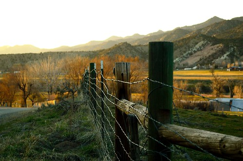 sunset mountains grass rural fence landscape colorado colorful sundown farm scenic barbedwire fencepost moutainrange