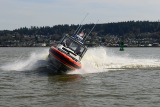 A 29-foot Response Boat - Small from Coast Guard Station Cape Disappointment makes a sharp turn to port during high speed maneuvers on the Columbia River off of Astoria, Ore., March 24, 2014. Twin 225 horsepower motors power the 29-foot RB-S, which gives the vessel extreme maneuverability and response capabilities. (U.S. Coast Guard photo by Petty Officer 1st Class David Mosley)