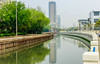 Canal in Shanghai by Cam Salsbury