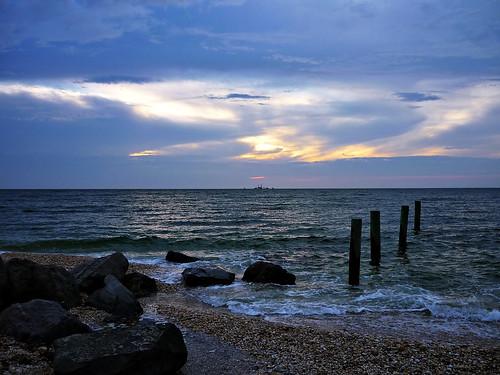sunset newyork night cloudy longislandsound jamesport longislandnorthshore ironpierbeach conocophillipsriverheadterminaloffshoreplatform