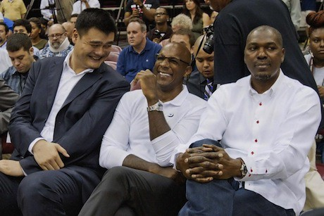 July 13, 2013 - Yao Ming shares a laugh with Clyde Drexler at the Dwight Howard press conference