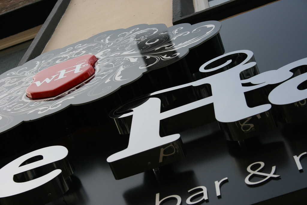 The White Hart, Built up 3D stainless steel letters with LED halo illumination, crest feature with back lit acrylic face and centre moulded translucent red acrylic shield, mounted on matte black aluminium sign trays