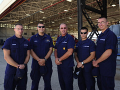 Master Chief Petty Officer of the Coast Guard Michael P. Leavitt poses with members of Sector Corpus Christi outside a hanger in Corpus Christi, TX,  August 11, 2013.