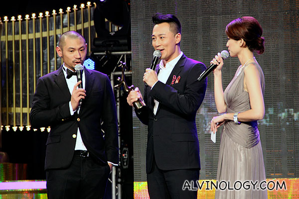 Raymond Lam on stage to collect his award