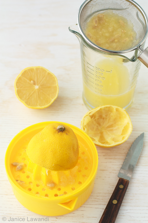 juicing a lemon by hand