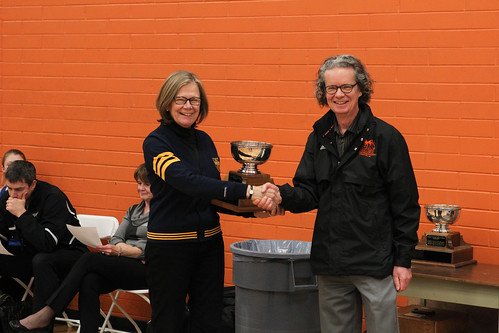 TRU's Alan Shaver presents UBCO's Deborah Buszard with 2013-14 Presidents womens cup (Snucins)