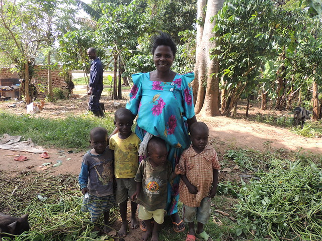 Mukono pig farmer Regina Nasamba and her children