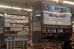 Cigarette displays above the cash registers in a Russian supermarket