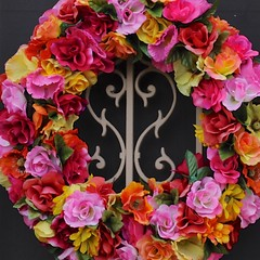 decor(0.0), flower arranging(0.0), christmas decoration(0.0), cut flowers(1.0), flower(1.0), artificial flower(1.0), floral design(1.0), flower bouquet(1.0), floristry(1.0), wreath(1.0), pink(1.0), petal(1.0),