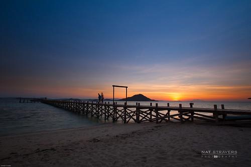 Sunset at Kanawa Island - Flores by Nathalie Stravers
