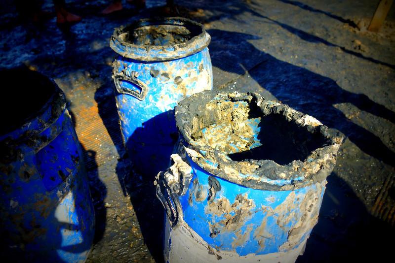 Bucket of black mud full of minerals, Dead Sea, Israel.