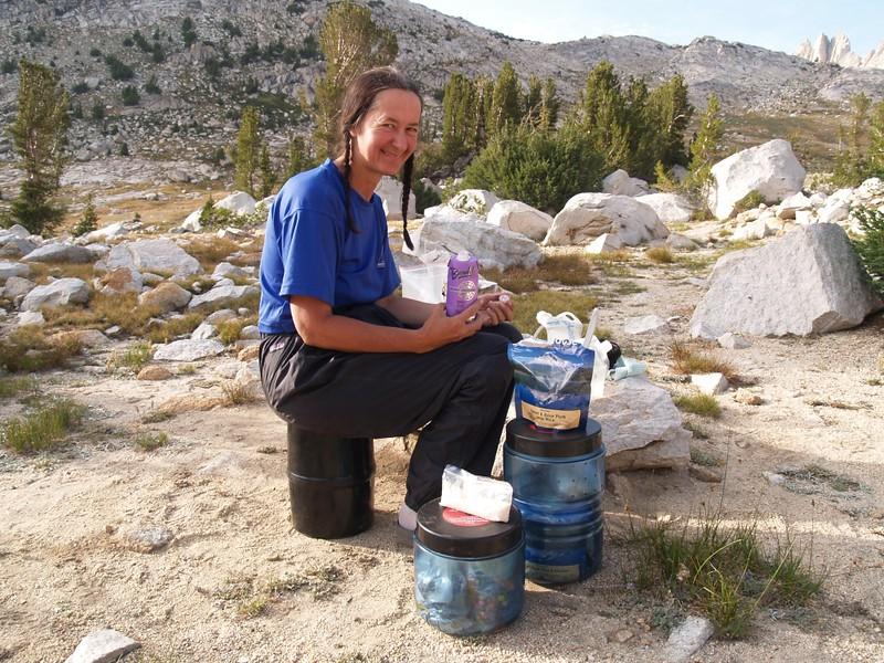 Vicki celebrating her climb of Matterhorn Peak with a box of wine