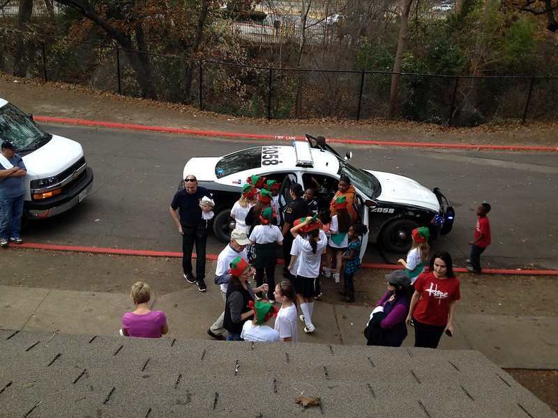 Elves In Disguise 2013: Dallas Police give the neighbors a cruiser tour.