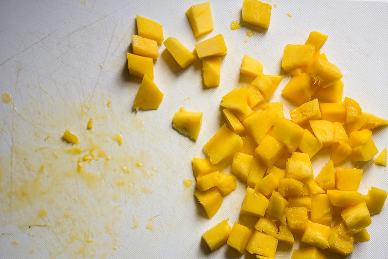 slice off cubes of mango