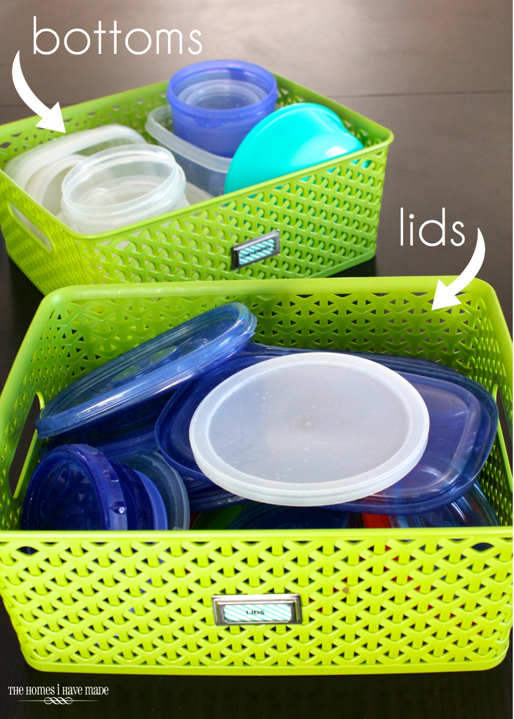 green baskets filled with tupperware bottoms and lids