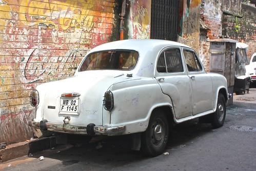 Kolkata car in front of a vintage Coca-Cola ad