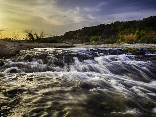 park blue sunset sky orange sun fall clouds river waterfall state pedernales donjschultephotography